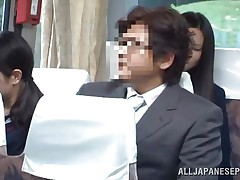 The cute asian schoolgirl got the wrong chair, or perhaps the right one because she is sitting near a pervert. The guy doesn't cares that the buss is filled with people, he just takes out his dick and puts her to jerk him. It looks like the schoolgirl is not so innocent because this little bitch masturbates too!